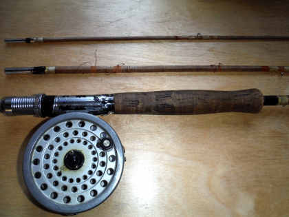 The little fly rod, now retired to Oliver's study wall