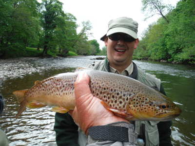 James Snelling with Usk brown trout caught on a small Iron Blue Parachute