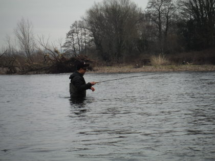 Malcolm Burch braving the weather to fish spiders on the Usk